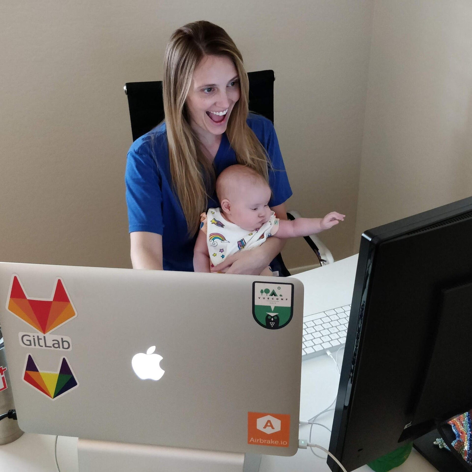 Me and my daughter attending a frontend meeting.